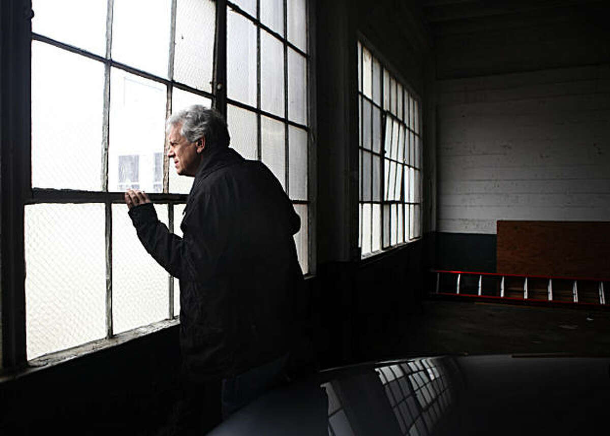 John Willis, owner/developer of 1945 Hyde Street, looks out a window of the 58-spot private parking garage which currently occupies the space on March 9, 2011 in San Francisco, California.