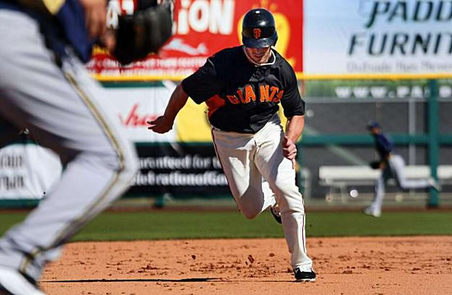 San Francisco Giant Aaron Rowand runs from second base and scores off a Freddy Sanchez base hit in the sixth inning during their game with the Milwaukee Brewers at Scottsdale Stadium in Scottsdale, Ariz. Friday, March 4, 2011. Photo: Lance Iversen, The Chronicle