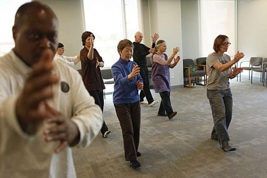 Tai Chi Chuan instructor Joseph Acquah, left, teaches Tai Chi Chuan at  the Osher Center for Integrative Medicine to a group of students including Kat Peirce( fifth from right to right), Grace Dote, Leon Lord, Susan Green and Alex Schott on Wednesday, February 9, 2011 in San Francisco, Calif. Photo: Lea Suzuki, The Chronicle