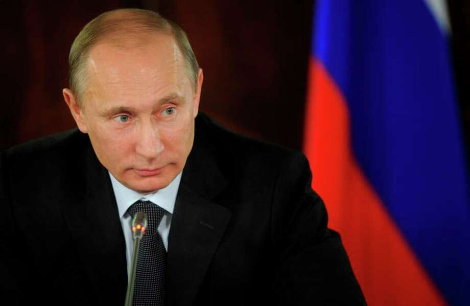 Vladimir Putin served two terms as Russia's president and is seeking a third. Photo: Associated Press, Alexei Druzhinin / POOL RIA Novosti