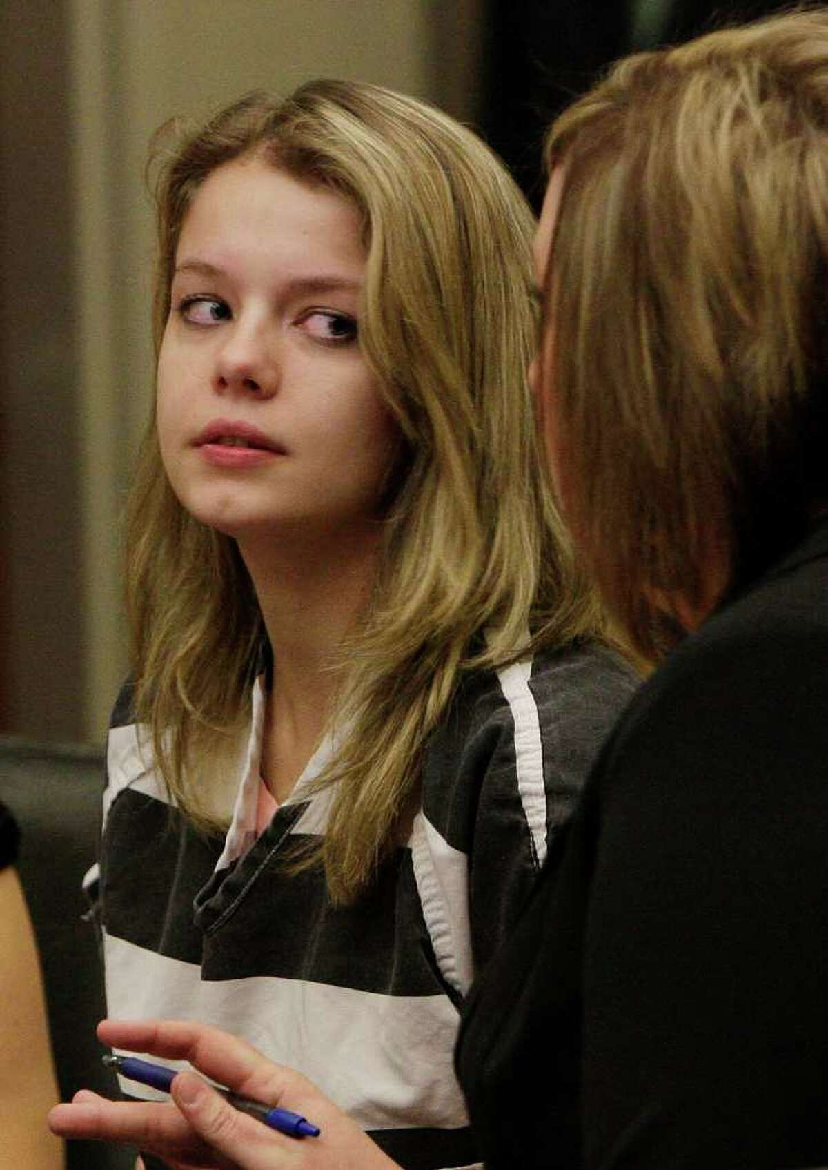 Elizabeth Johnson, left, mother of missing baby Gabriel, listens to her attorney Vanessa Smith, as Johnson appears for a hearing in Maricopa County Superior Court Wednesday, March 17, 2010, in Phoenix. Johnson had refused to leave her cell for a court hearing last week, but Judge Timothy Ryan ordered deputies to