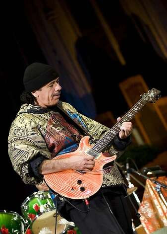 Spirit of Giving concert ñ Carlos Santana ñ Carlos Santana on guitar.       Ran on: 12-23-2007 The Spirit of Giving concert raised funds for award-winning singer Angela Bofill, who has recently suffered from health problems. Clockwise from top left: Narada Michael Walden; Jeanie Tracy; Carlos Santana; and Shauna Vincent (left) and her mom, Bofill. Ran on: 12-23-2007  Ran on: 12-23-2007   Ran on: 12-08-2011 Photo caption Dummy text goes here. Dummy text goes here. Dummy text goes here. Dummy text goes here. Dummy text goes here. Dummy text goes here. Dummy text goes here. Dummy text goes here. Photo: Gene Kosoy