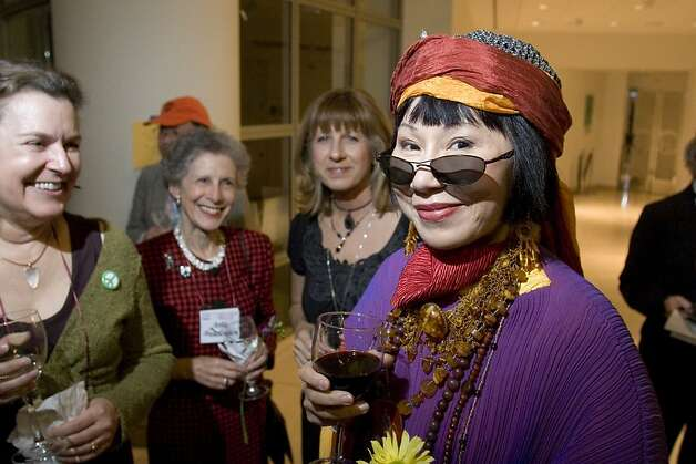 Friends of the San Francisco Public Library held its annual Library Laureates dinner at the Main Library. From left: TK, tk, tk and Laureate Amy Tan. Ran on: 05-20-2007   Ran on: 12-08-2011 Photo caption Dummy text goes here. Dummy text goes here. Dummy text goes here. Dummy text goes here. Dummy text goes here. Dummy text goes here. Dummy text goes here. Dummy text goes here.###Photo: edit08_PH71176854400sfc###Live Caption:###Caption History:Friends of the San Francisco Public Library held its annual Library Laureates dinner at the Main Library.__From left: TK, tk, tk and Laureate Amy Tan.__Ran on: 05-20-2007###Notes:###Special Instructions: Photo: Ralph Granich, Special To The Chronicle