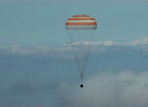 The Soyuz space capsule carrying Bellevue software billionaire Charles Simonyi returns to Earth. Photo: MAXIM MARMUR, SPACE ADVENTURES / MAXIM MARMUR