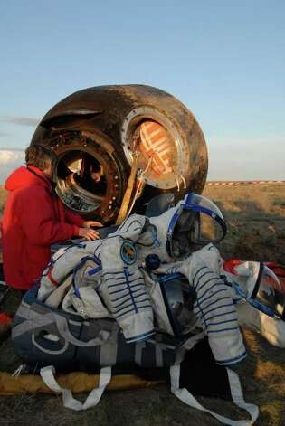 The Soyuz space capsule that carried Bellevue software billionaire Charles Simonyi is shown after its return to Earth. Photo: MAXIM MARMUR, SPACE ADVENTURES