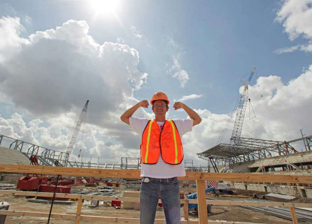 The Houston Dynamo soccer team's Bobby Boswell poses for a photograph for teammates during a tour the Dynamo's new stadium under construction Monday, Oct. 10, 2011, in Houston. ( James Nielsen / Chronicle )