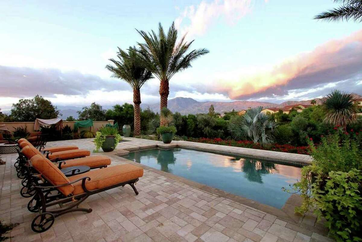 Professional golfer Fred Couples has listed his second home in La Quinta at $4.195 million.The Spanish-style villa has a courtyard with a fountain. The nearly half-acre site has mountain views, a swimming pool with a spa and a fire pit.