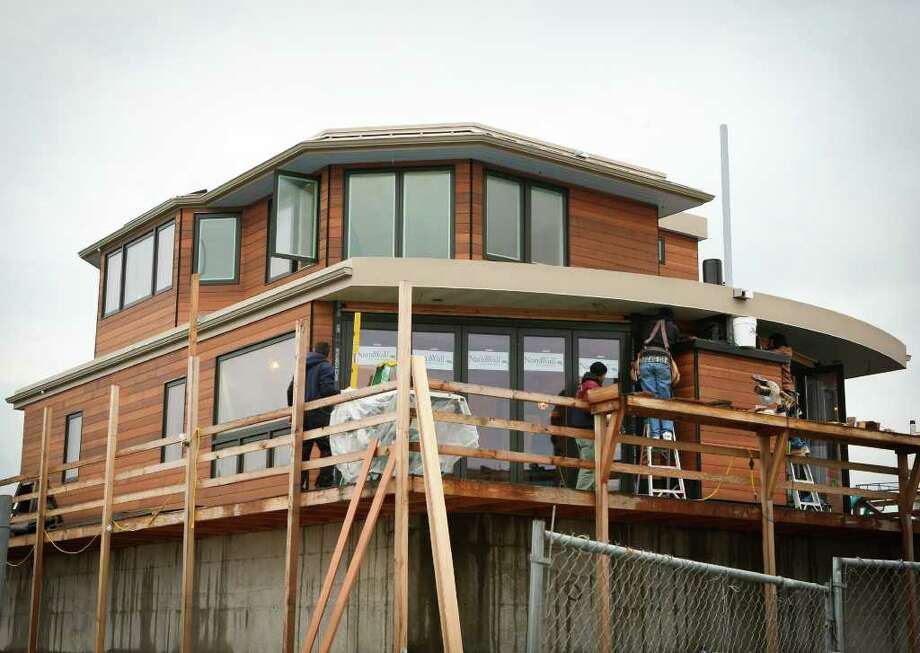 Workers at Little & Little Construction, in Port Townsend, build a floating home. Photo: Debra Swanson/Little & Little Construction