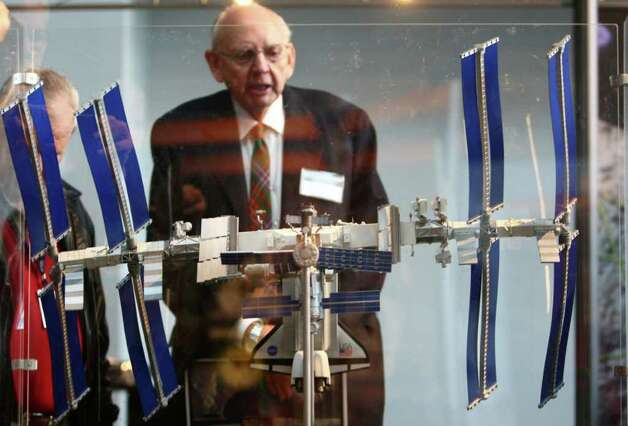 A model of the International Space Station draws visitors during a dedication ceremony for the Museum of Flight's new Charles Simonyi Space Gallery. The gallery will feature as its centerpiece the Space Shuttle Full-Fuselage Trainer. The shuttle trainer will be delivered in stages beginning in June 2012. Photo: JOSHUA TRUJILLO / SEATTLEPI.COM