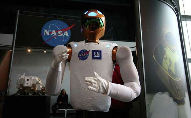 "A model of ""Robonaut 2"" is shown during a dedication ceremony for the Museum of Flight's new Charles Simonyi Space Gallery. The gallery will feature as its centerpiece the Space Shuttle Full-Fuselage Trainer. The shuttle trainer will be delivered in stages beginning in June 2012. Photo: JOSHUA TRUJILLO / SEATTLEPI.COM"