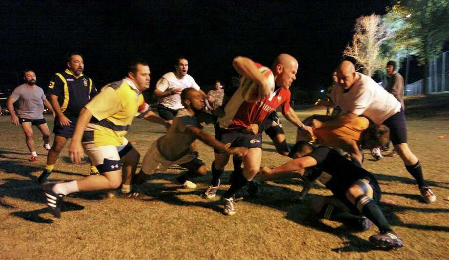 Members of the Alamo City Rugby Football Club practice last week at the University of Texas Health Science Center athletic field. The club's charitable endeavors include raising money for cystic fibrosis and volunteering at the food bank. Photo: EDWARD A. ORNELAS, SAN ANTONIO EXPRESS-NEWS / © SAN ANTONIO EXPRESS-NEWS (NFS)