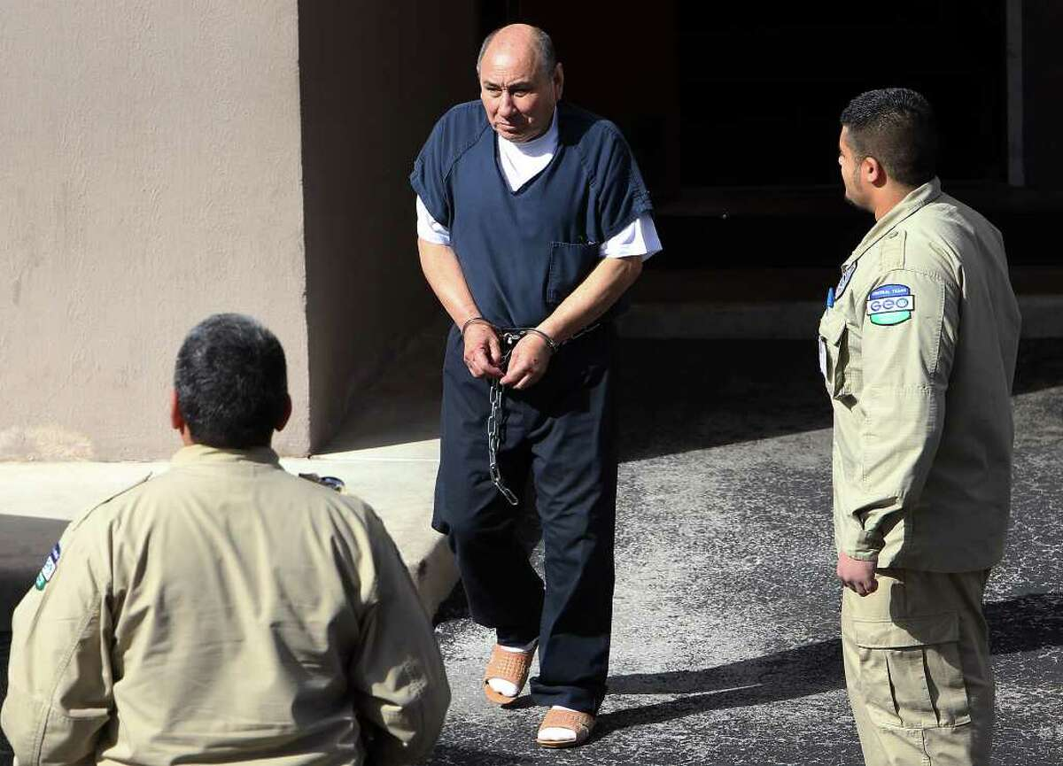 Alleged founder of the Juárez Cartel Juan Jose Quintero Payán (center) was sentenced for 18 years in federal prison on racketeering charges on Thursday, Dec. 8, 2011.