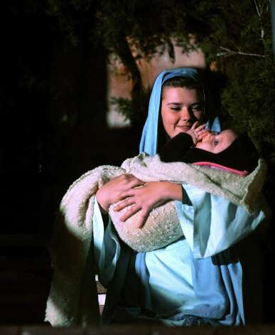 "Mary, played by Aleiha Sawyers, holds the Christ child, played by Jessika Brenner, during the ""A Walk in Bethlehem"" event at St. Helena's Episcopal Church in Boerne in this 2011 photo. The annual event is attended by thousands. Photo: BILLY CALZADA, SAN ANTONIO EXPRESS-NEWS / gcalzada@express-news.net"