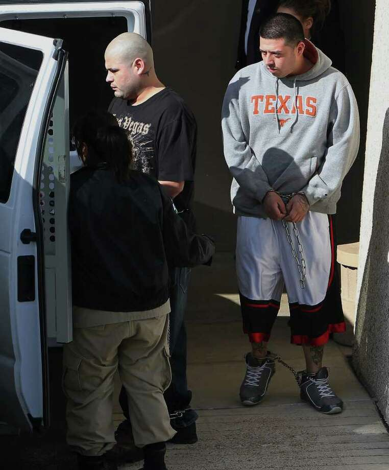 Jerry Donel (by vehicle) and Adam Chavez (right) are alleged to be members of the Texas Syndicate. Photo: KIN MAN HUI, SAN ANTONIO EXPRESS-NEWS / SAN ANTONIO EXPRESS-NEWS