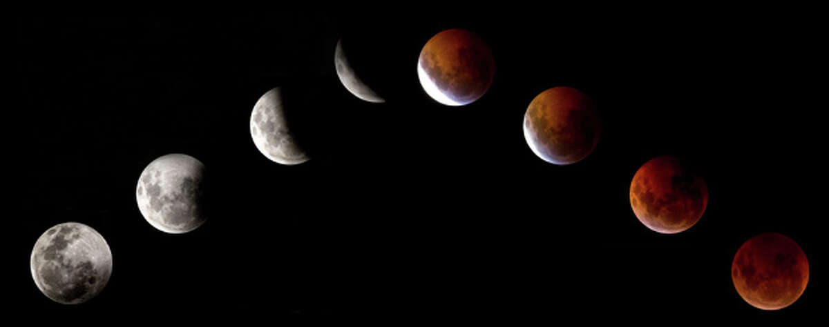 This combination of pictures shows the moon in various stages of a total lunar eclipse as seen from Mexico city on December 21, 2010. This eclipse takes place just hours before the December solstice, which marks the beginning of northern winter and southern summer. AFP PHOTO/Luis Acosta