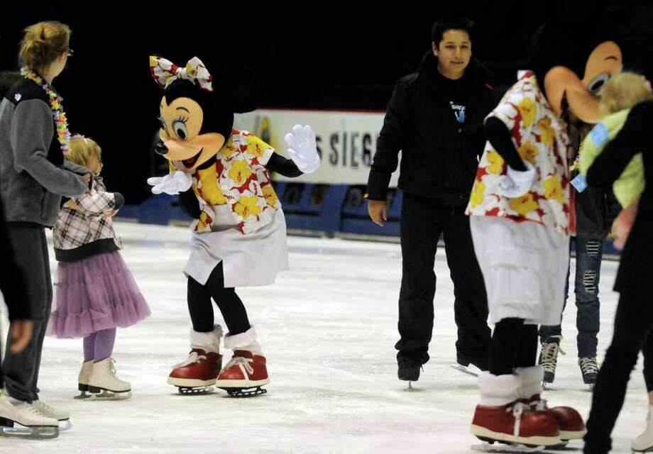 Minnie and Mickey mouse mingle with Make-A-Wish children and their families during a preview of Disney On Ice presents Mickey & Minnie's Magical Journey skating party at the Times Union Center in Albany NY Thursday, Dec.8, 2011.( Michael P. Farrell/Times Union) Photo: Michael P. Farrell