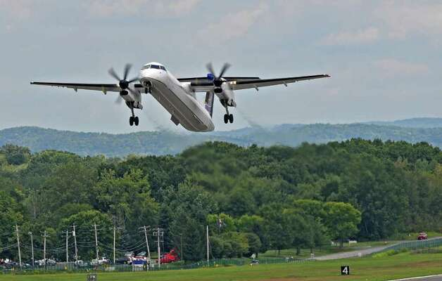A United Q400 turboprop takes off from Albany International Airport on Monday Aug. 22, 2011 in Colonie, NY. ( Philip Kamrass/ Times Union) Photo: Philip Kamrass / 00014368A