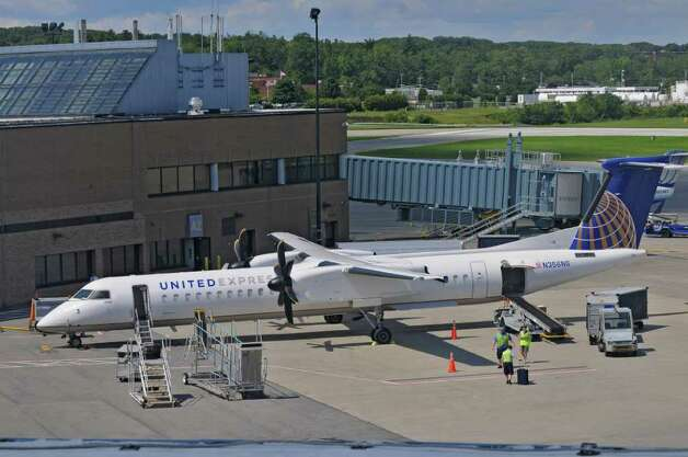 A United Q400 turboprop prepares to depart from Albany International Airport on Monday Aug. 22, 2011 in Colonie, NY. ( Philip Kamrass/ Times Union) Photo: Philip Kamrass / 00014368A