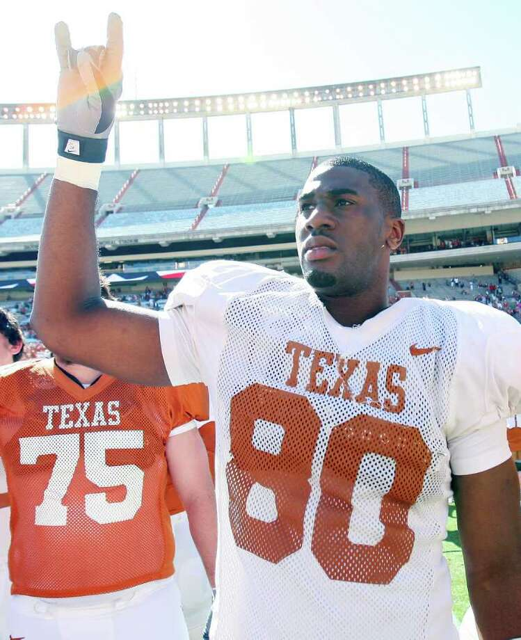 FOR SPORTS - Texas' Alex Okafor flashes the Hook 'em Horns after the Orange-White Scrimmage held Sunday April 5, 2009 at Darrell K Royal-Texas Memorial Stadium in Austin, Tx. The Orange won 21-7. (PHOTO BY EDWARD A. ORNELAS/eaornelas@express-news.net) Photo: EDWARD A. ORNELAS, SAN ANTONIO EXPRESS-NEWS / eaornelas@express-news.net