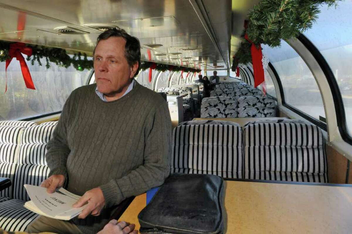 Iowa Pacific Holdings president Ed Ellis on board the Polar Express in 2011. A plan to store old rail cars has drawn the ire of environmentalists. (File photo)
