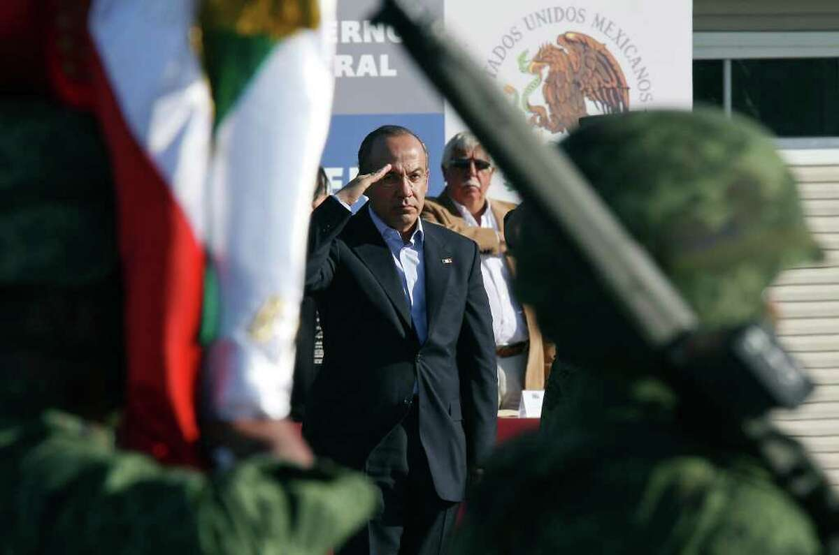 Mexican President Felipe Calderón salutes during a dedication ceremony for a new army barracks in Ciudad Mier in Tamaulipas state.