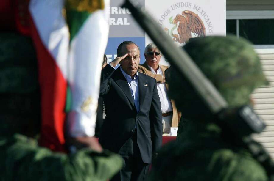 Mexican President Felipe Calderón salutes during a dedication ceremony for a new army barracks in Ciudad Mier in Tamaulipas state. Photo: EDWARD A. ORNELAS, SAN ANTONIO EXPRESS-NEWS / © SAN ANTONIO EXPRESS-NEWS (NFS)