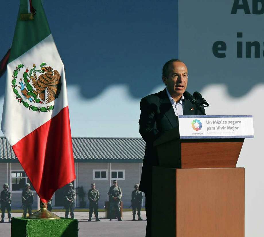 Mexican President Felipe Calderón speaks during a dedication ceremony for the new army base on Thursday Dec. 8, 2011 in Ciudad Mier, Tamaulipas, Mexico. Photo: EDWARD A. ORNELAS, SAN ANTONIO EXPRESS-NEWS / © SAN ANTONIO EXPRESS-NEWS (NFS)