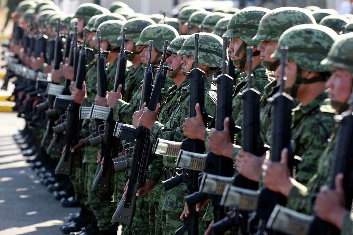 Mexican soldiers take part in the ceremony. The temporary barracks is part of what Calderón plans as a strategic buildup throughout the country's embattled northern border.