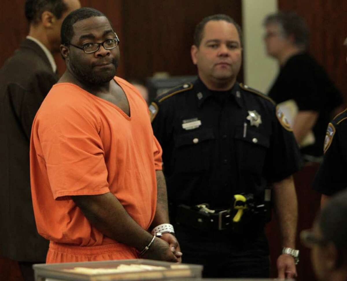 LaDondrell Montgomery is escorted from court on Thursday after his 2009 robbery conviction was thrown out.