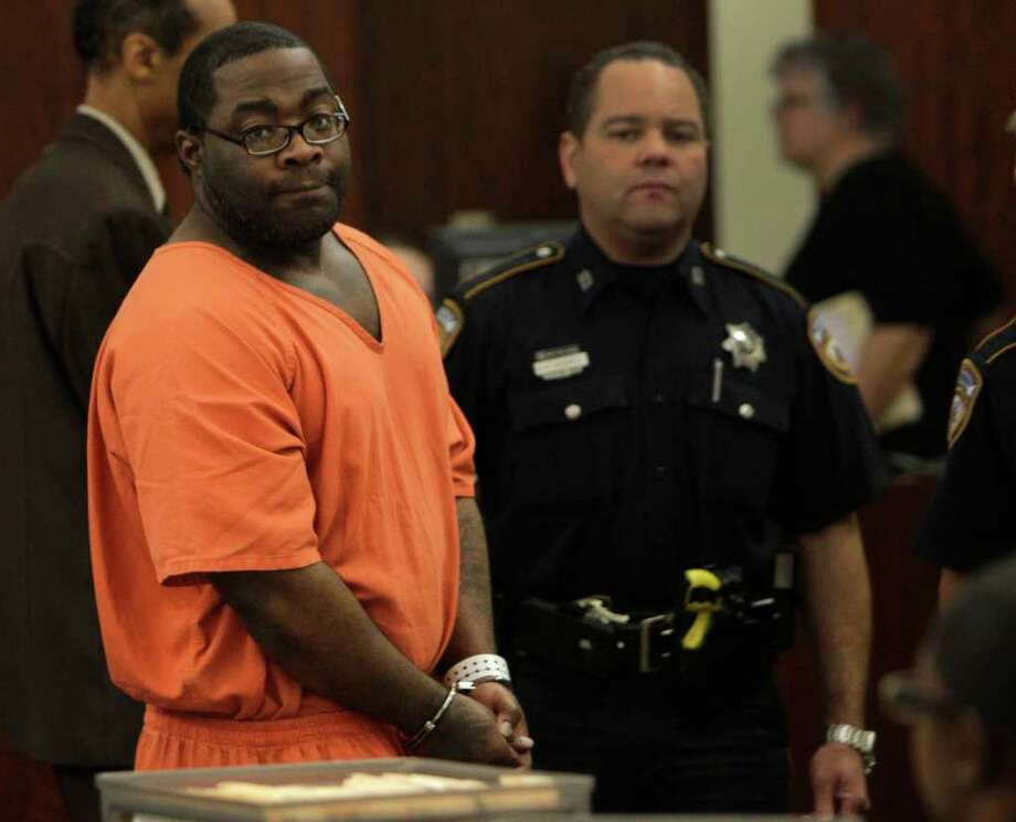 LaDondrell Montgomery is escorted from court on Thursday after his 2009 robbery conviction was thrown out. Photo: Melissa Phillip / © 2011 Houston Chronicle