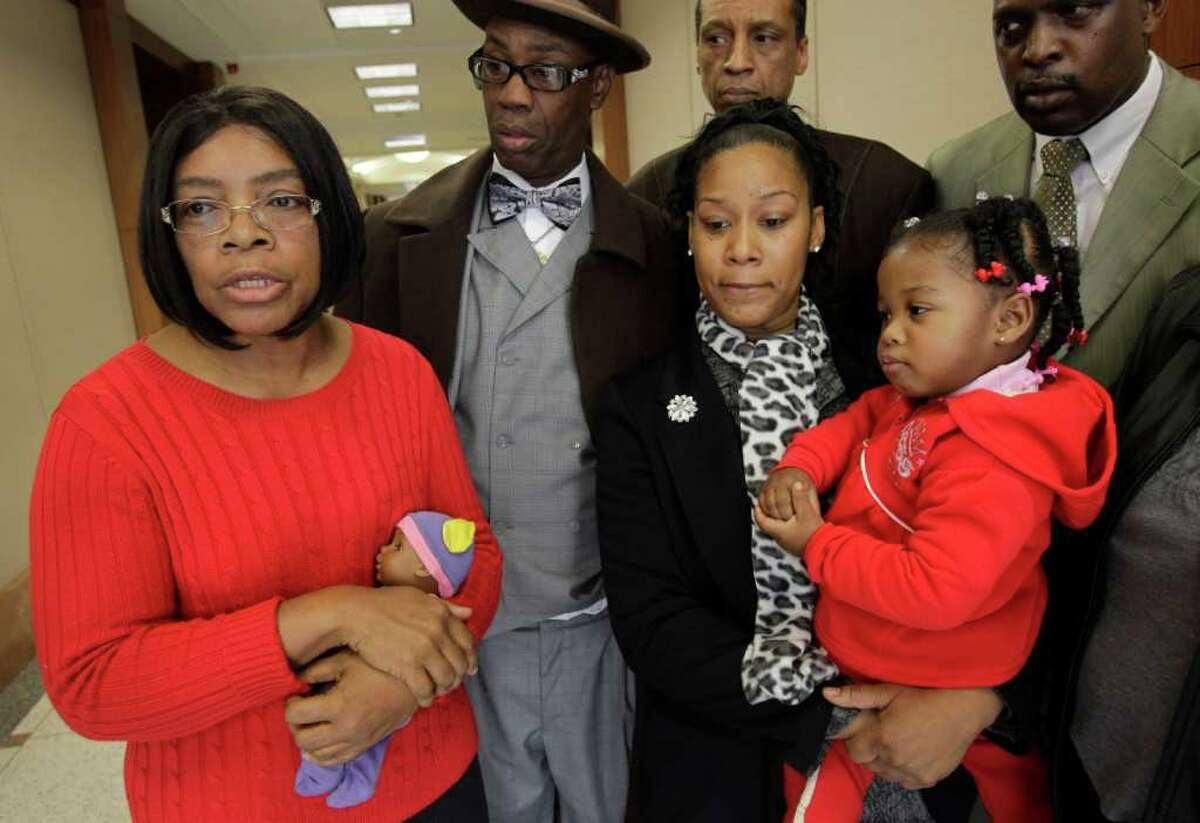 Earnestine Wells, left, speaks to the media Thursday outside the 351st District Criminal Court about her son, LaDondrell Montgomery. With her are Minister Johnny B. Jeremiah, left, Shanthina Gilguillory Montgomery, wife of LaDondrell Montgomery, and their daughter, Nariyah, 2, attorney Ronald Ray, back center, and Charlie Jones, right.
