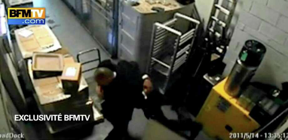 In this image made from surveillance video obtained by France's BFM television and publicly aired for the first time Thursday, Dec. 8, 2011, two Sofitel hotel employees dance in a basement corridor of the hotel in New York on May 14, 2011. Hotel maid Nafissatou Diallo accused Dominique Strauss-Kahn of sexual assault in his room. The video is the basis of recent news reports suggesting Strauss-Kahn might have been the target of a political plot. (AP Photo)