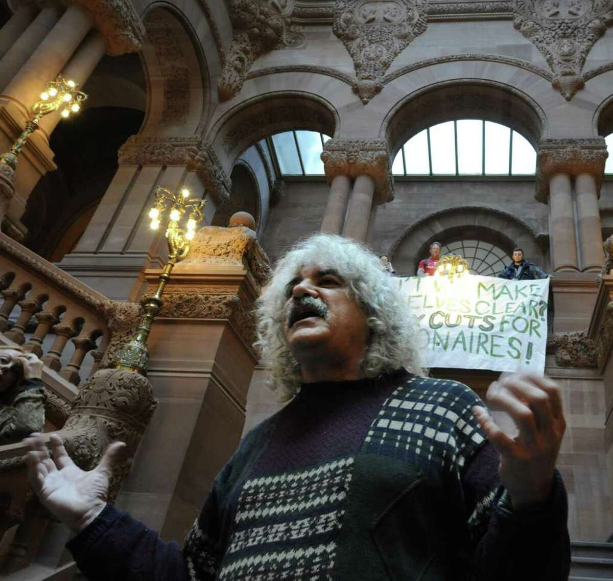 """CSEA member Joe Lombardo adds his feelings to a discussion of """"The Real Rent Reform"""" campaign on the steps of the Million Dollar staircase in the State Capitol in Albany, N.Y. Dec. 8, 2011. (Skip Dickstein/Times Union)"""