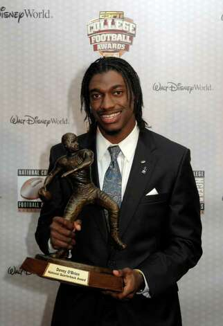 Baylor quarterback Robert Griffin III poses with the Davey O'Brien Award for the nation's top college quarterback, during the College Football Awards show in Lake Buena Vista, Fla., Thursday, Dec. 8, 2011 . Photo: AP