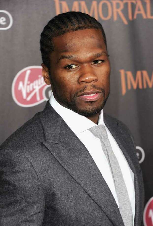 "Rapper 50 Cent was expelled from high school in the 10th grade for cocaine possession, later admitted he sold crack and has had several cocaine ""scandals"" during his time rapping. Photo: Jason Merritt, Getty Images For Relativity Medi / 2011 Getty Images"