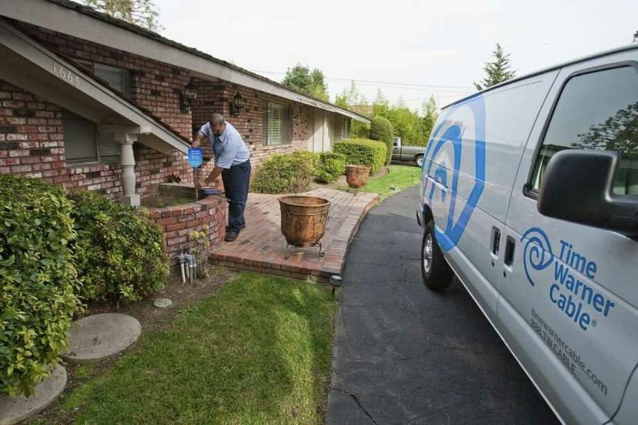 San Antonians may be more familiar with TV service provider Time Warner Cable, which is tied for 4th least trusted company at 25 percent TTR.  Photo: Allen J. Schaben, MCT / Los Angeles Times