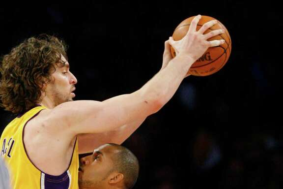 Nick de la Torre: Chronicle HOLD EVERYTHING: Lakers center Pau Gasol, top, would have come to the Rockets in a deal that was supposed to include Luis Scola and Kevin Martin.