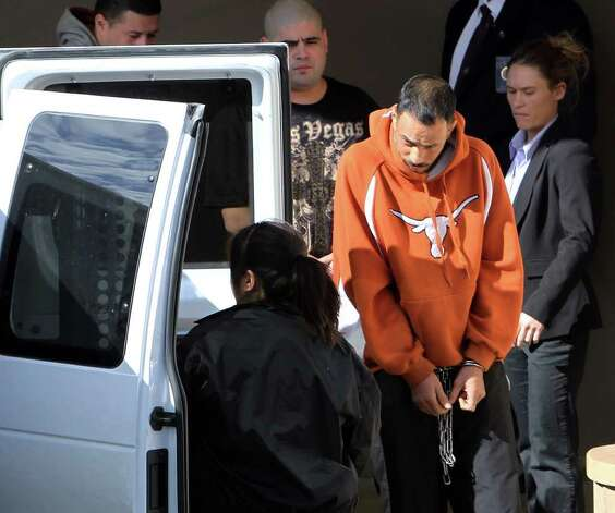 Raymond Ramirez (foreground) is one of four alleged members of the Texas Syndicate that had a hearing Tuesday on charges of racketeering. Following Ramirez are Jerry Donel and Adam Chavez. Photo: KIN MAN HUI, SAN ANTONIO EXPRESS-NEWS / SAN ANTONIO EXPRESS-NEWS