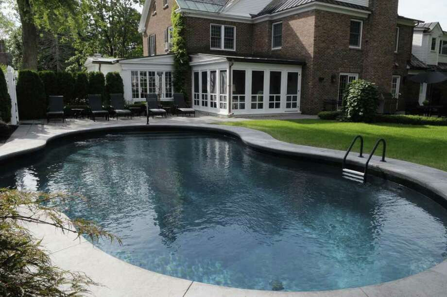 A view of the backyard patio and pool area of Sharlene Doherty's house on Wednesday, Aug. 24, 2011 in Albany. (Paul Buckowski / Times Union) Photo: Paul Buckowski / 00014362A