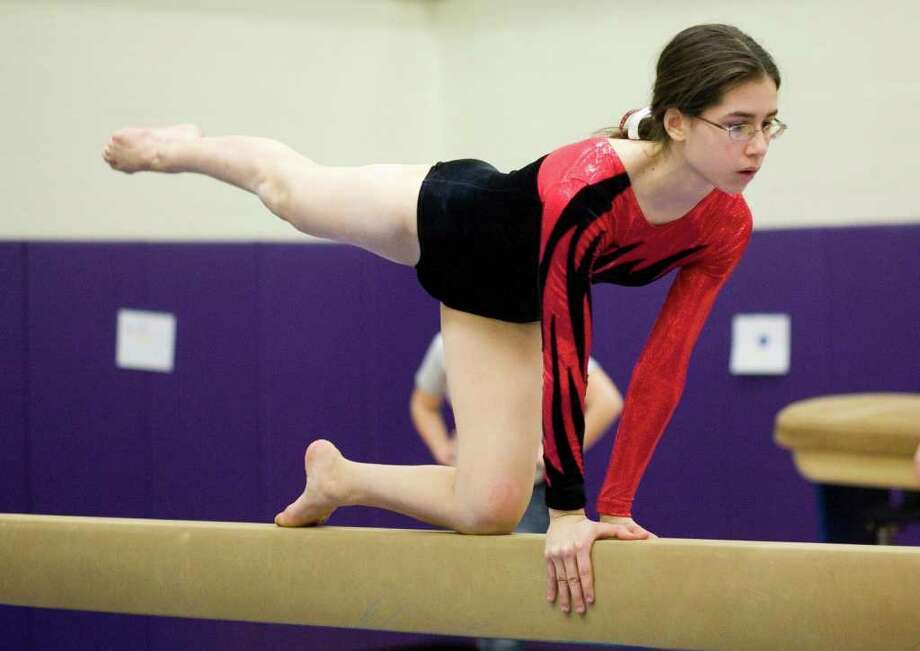 New Canaan High School's Victoria Gerardi competes on the balance beam during a gymnastics meet at Westhill in Stamford, CT, on Feb 4, 2010. Special Dru Nadler Photo: Kerry Sherck, ST / Stamford Advocate Freelance