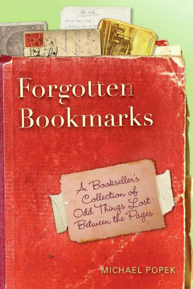 """The cover of """"Forgotten Bookmarks:  A Bookseller?s Collection of Odd Things Lost Between the Pages,"""" by Michael Popek."""