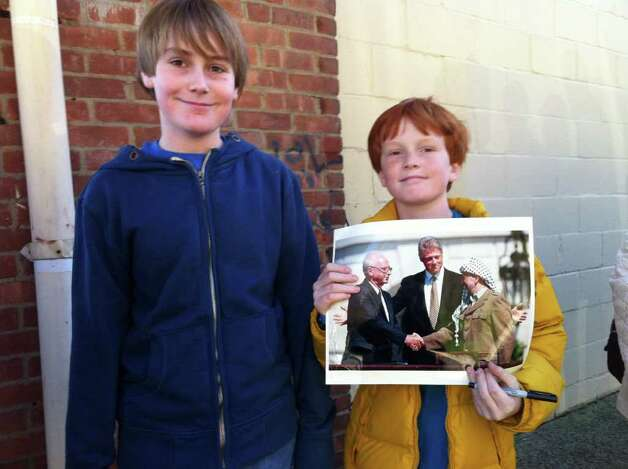 Thomas ( left) and Douglas Waylett-Brown took time off from school today and in the hopes Bill Clinton will sign a photo for them. Photo: Ben Holbrook