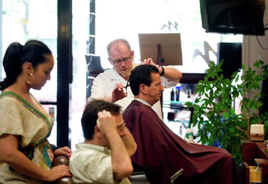 Gov. Dan Malloy gets his hair cut at Montana for Men in Stamford, Conn. on Wednesday June 1, 2011. Opponents of the budget fought the proposed tax hikes on boats and services like hairstyling and car washing. Photo: Kathleen O'Rourke / Stamford Advocate