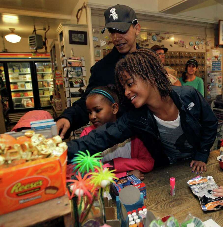 A reader criticizes the cost and frequency of President Barack Obama's family vacations. Here's the president and daughters Sasha (left) and Malia at Martha's Vineyard in August 2009. / AP