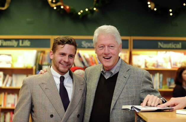 "Former President Bill Clinton poses for a photo with Rob Munro, of Darien, during a signing event for his book, ""Back to Work: Why We Need Smart Government for a Strong Economy,"" Friday, Dec. 9, 2011 at Barrett Bookstore in Darien, Conn. Photo: Autumn Driscoll / Connecticut Post"