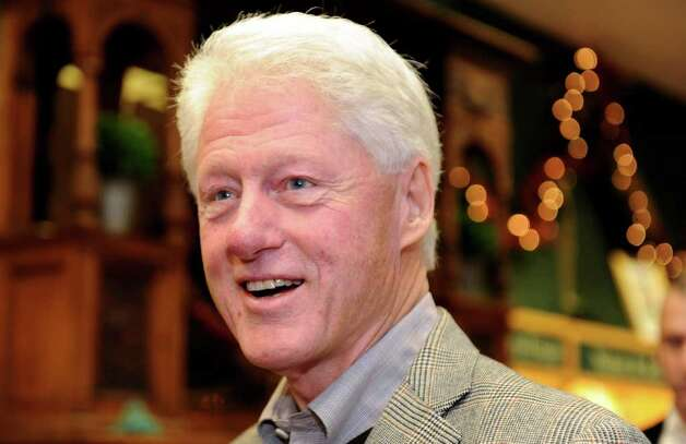 "Former President Bill Clinton signs copies of his book, ""Back to Work: Why We Need Smart Government for a Strong Economy,"" Friday, Dec. 9, 2011 at Barrett Bookstore in Darien, Conn. Photo: Autumn Driscoll / Connecticut Post"
