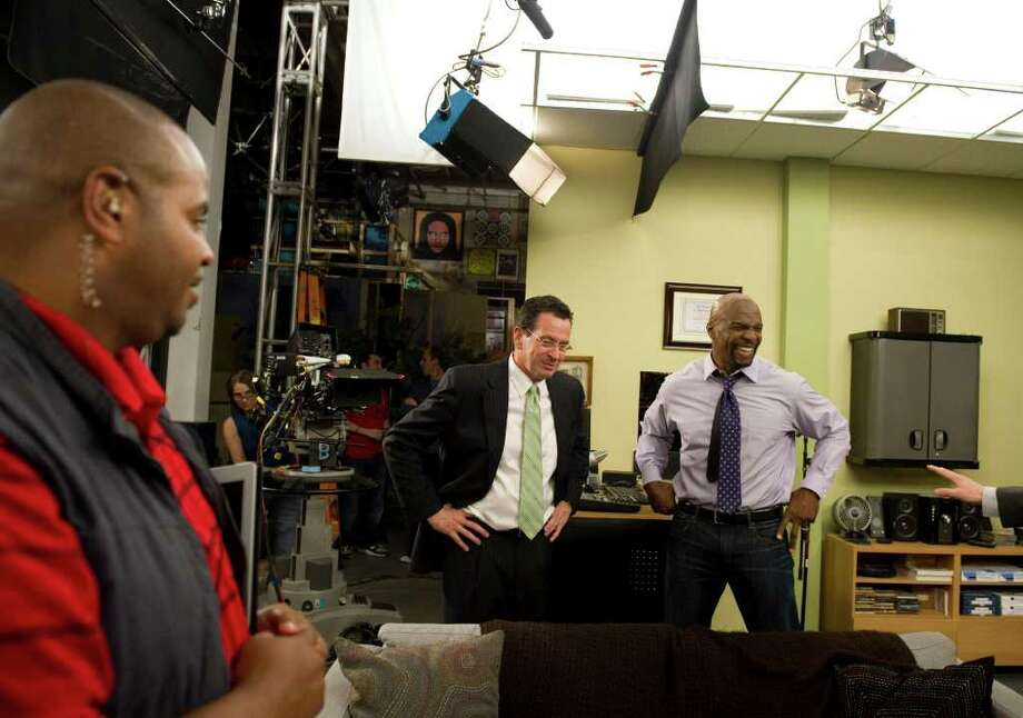 "Gov. Dan Malloy on the set of the sitcom ""Are We There Yet?"", with star Terry Crews, during a tour of the Connecticut Film Center in Stamford, Conn. on Wednesday May 11, 2011. The administration came close to a deal with the unions later that night. Photo: Kathleen O'Rourke / Stamford Advocate"