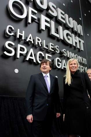 Charles and Lisa Simonyi pose in front of the Seattle Museum of Flight's new Charles Simonyi Space Gallery after its unveiling on Thursday, Dec. 8, 2011. Photo: Ted Huetter / The Museum of Flight, Seattle