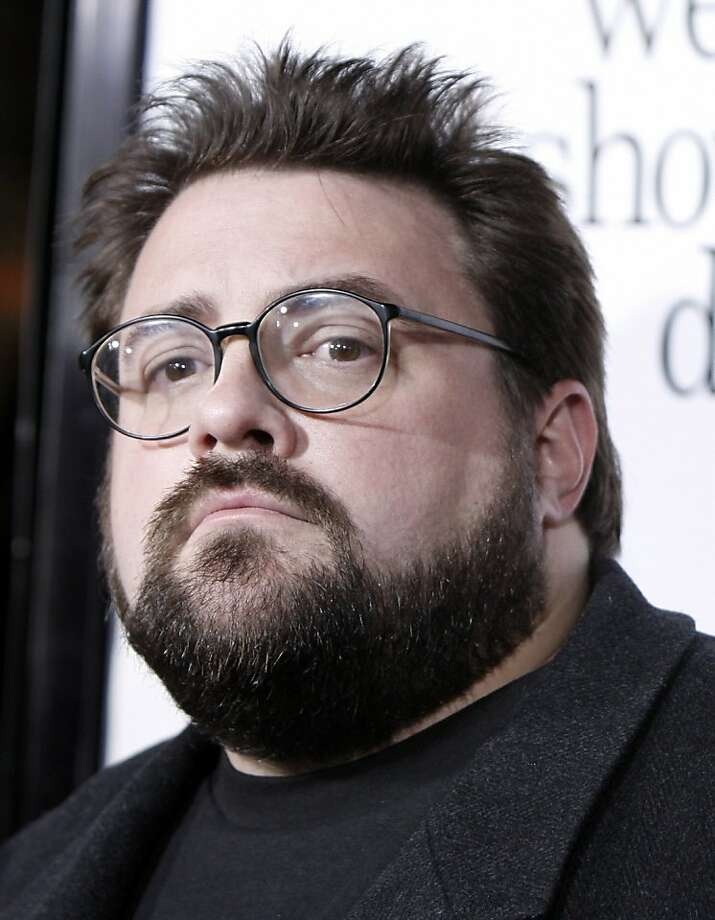 "FILE - In this Oct. 20, 2008 file photo Kevin Smith arrives at the premiere of ""Zach and Miri Make A Porno"" in Los Angeles.  (AP Photo/Matt Sayles, File)   Ran on: 02-21-2010 Being bumped from a flight over his size angered director Kevin Smith. Ran on: 02-21-2010 Being bumped from a flight over his size angered director Kevin Smith. Photo: Matt Sayles, AP"