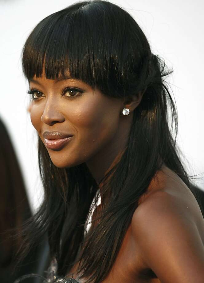 File - In this Thursday, May 20, 2010 file photo, British model Naomi Campbell arrives for the amfAR Cinema Against AIDS benefit, during the 63rd Cannes international film festival, in Cap d'Antibes, southern France. Supermodel Naomi Campbell, who has been avoiding international prosecutors for the past year, will be forced to appear on the witness stand in the war crimes trial of former Liberian President Charles Taylor. In a ruling published Thursday, July 1, 2010, judges of the Special Court for Sierra Leone ordered a subpoena served on Campbell and if necessary to enlist the help of law enforcement agencies wherever she is found to make sure she gets to court. (AP Photo/Matt Sayles, file)  Ran on: 07-02-2010 Naomi Campbell has been subpoenaed in a  war crimes trial. Photo: Matt Sayles, AP